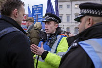 29-01-2019 - Police speaking to a Brexit protester. Brexit supporters protest, Houses of Parliament as MPs vote on amendments withdrawal deal with the EU, Westminster, London © Philip Wolmuth