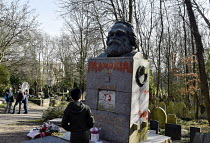 17-02-2019 - Marx Memorial vandalised, Highgate Cemetery, London. Visitors to Highgate Cemetery looking on at the memorial to Karl Marx after its initial cleaning to remove the worst of the graffiti that besmirche... © Stefano Cagnoni