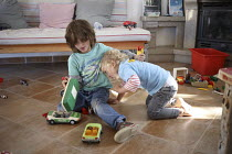 28-10-2018 - Brothers fighting over toys, family holiday, Arrifana, Algarve, Portugal © Paul Box