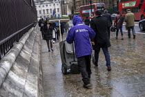 14-03-2019 - Westminster street cleaner in the rain, London © Jess Hurd