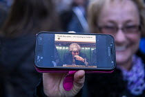 14-03-2019 - Teresa May drinking a pint of Guiness Fuck This Shit I'm Moving to Ireland meme on a remain campaigners phone, protest outside Parliament during votes on how the UK leaves the European Union, Westmins... © Jess Hurd