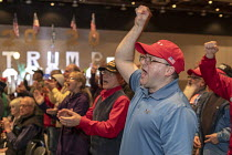14-03-2019 - Detroit, Michigan, USA: We Build the Wall Rally to promote construction of a Mexican border wall. Enthusiastic audience with Make America Great Again and Donald Trump baseball caps © Jim West
