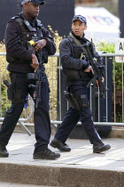 26-03-2019 - Armed police officers on patrol outside Parliament, Westminster, London © David Mansell