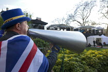 26-03-2019 - Steve Bray anti Brexit protestor shouting No Brexit! down a megaphone as pro Leave MPs are interviewed on TV, Parliament, College Green, Westminster, London. In his daily protest he is often heard dur... © David Mansell