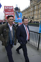 27-03-2019 - Arron Banks co-founder of the  Leave.EU campaign and Andy Wigmore (L) walking through Remain anti Brexit protest opposite the Houses of Parliament, Westminster, London © David Mansell