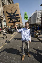 15-04-2019 - Middle Class protester, Extinction Rebellion protest, Oxford Circus against lack of government action on climate change. Nonviolent direct action simultaneous blocking London. © Jess Hurd