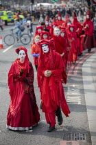 17-04-2019 - The Invisible Circus, Extinction Rebellion activists dressed in red robes and with white makeup, Extinction Rebellion protest, Parliament Square against lack of government action on climate change. No... © Jess Hurd