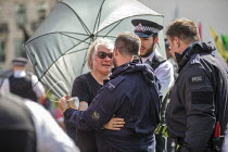 19-04-2019 - Woman hugs a police officer after being released from a lock-on during eviction of Extinction Rebellion climate change campaigners, occupation of Oxford Circus, London. © Jess Hurd
