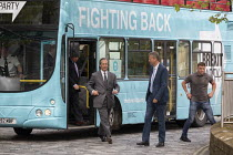 15-05-2019 - Nigel Farage Brexit Party walking down the High Street Merthyr Tydfil, South Wales, Nathan Gill (R) and campaign bus © John Harris