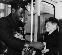 09-09-1960 - Black bus conductor and schoolboy, London Routemaster bus 1960 © Malcolm Aird