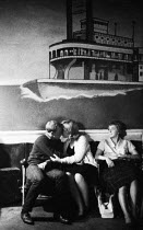 08-10-1961 - Young couple sitting and kissing, jazz club, West End, London 1961Young couple sitting and kissing, jazz club, West End, London 1961Young couple sitting and kissing, jazz club, West End, London 1961Yo... © Romano Cagnoni