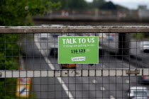 24-05-2019 - Samaritans sign Talk to Us if things are getting to you, motorway bridge, West Midlands. Their helpline can help those wanting to commit suicide © John Harris