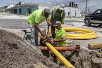 09-05-2019 - Mexico Beach, Florida, USA: Workers replacing a gas pipe 7 months after the town was devastated by Hurricane Michael © Jim West