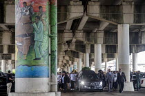 11-05-2019 - New Orleans, Louisiana, USA: Funeral procession ends under the Interstate highway © Jim West