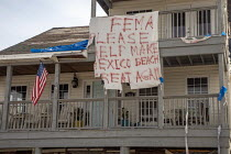 10-05-2019 - Mexico Beach, Florida, USA: A plea for help from the Federal Emergency Management Agency hanging on a damaged home. Destruction from Hurricane Michael 7 months after the storm hit the Florida Panhandl... © Jim West