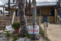 10-05-2019 - Mexico Beach, Florida, USA: A home with a Not For Sale sign. Destruction from Hurricane Michael 7 months after the storm hit the Florida Panhandle © Jim West