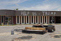 09-05-2019 - Panama City, Florida, USA: Help Us Trump scrawled on a damaged store. Destruction from Hurricane Michael 7 months after the storm hit the Florida Panhandle © Jim West