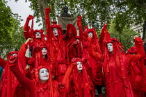 04-06-2019 - The Invisible Circus, Extinction Rebellion activists dressed in red robes and with white makeup, Together Against Trump, stop the state visit protest against Donald Trump, London. Courage calls to cou... © Jess Hurd