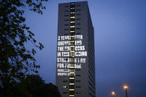 12-06-2019 - Projection of a message about tower block fire safety by Grenfell United onto Cruddas Park Tower, Newcastle Upon Tyne. 2 Years After Grenfell And The Fire Doors in this Building Still Aren't Fit For P... © Mark Pinder