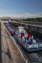 05-20-2019 - Louisville, Kentucky, USA: Marathon Petroleum towboat Paul G Blazer pushing oil barges through the McAlpine Lock, Ohio River © Jim West