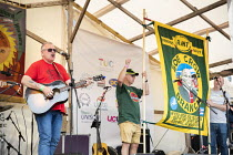 21-07-2019 - Robb Johnson with new RMT Bob Crow Branch banner, Tolpuddle Martyrs Festival, Dorset. © Jess Hurd