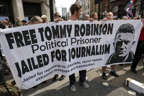 03-08-2019 - Free Tommy Robinson protest, BBC Portland Place, London. Banner claiming he is a political prisoner and jailed for journalism © Jess Hurd