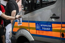 03-08-2019 - Free Tommy Robinson protest, BBC Portland Place, London. Sticker on a Police van © Jess Hurd
