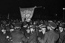 20-11-1983 - Policing the NGA Stockport Messenger dispute, Warrington, 1983. Newspaper owner Eddy Shah hired non union printers to break the printer workers union. Port of London TGWU Banner © Peter Arkell