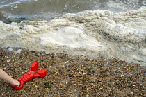 08-08-2019 - Spume, child and red toy lobster, Leigh-on-Sea, Essex © Jess Hurd