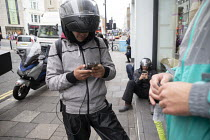09-09-2019 - Uber Eats and Deliveroo riders waiting for work, Brighton © John Harris