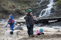 19-03-2018 - Family play in the snow. Mwnt Beach, Cardigan Bay, Ceredigion, Wales © Paul Box
