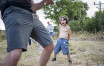 14-07-2018 - Boy dancing to music at a silent disco, Pembrokeshire, Wales © Paul Box