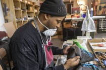 15-10-2019 - Detroit, Michigan, USA: An Air Force veteran making footwear, Pingree Detroit. Pingree is a worker owned company that hires veterans to make footwear and other products with leather reclaimed from the... © Jim West