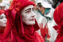 18-10-2019 - The Invisible Circus, Extinction Rebellion activists dressed in red robes and with white makeup. Extinction Rebellion red hand, last day protesting against lack of Government action on climate change.... © Jess Hurd