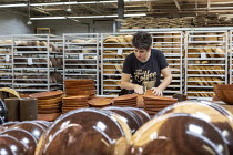 10-10-2019 - Michigan, USA: worker polishing wooden bowls, The Holland Bowl Mill, which manufactures bowls and other wood products © Jim West