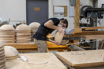 10-10-2019 - Michigan, USA: worker sanding wooden bowls, The Holland Bowl Mill, which manufactures bowls and other wood products © Jim West