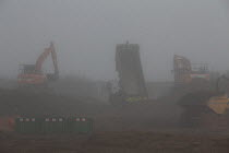 23-10-2019 - Construction of new housing, morning mist, Stratford upon Avon, Warwickshire. Spitfire Homes © John Harris
