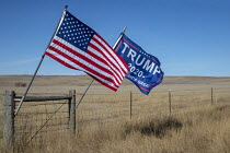 07-11-2019 - Wright, Wyoming, USA Trump 2020 and American flag on a ranch © Jim West