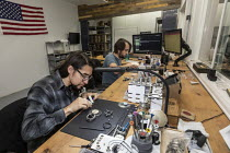 14-11-2019 - Colorado, USA. Workers making watches by hand, Vortic Watch Company. The company salvages and restores antique pocket watches, making them into expensive wrist watches © Jim West