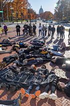 11-29-2019 - Washington DC USA. Young activists staged a die in during a Funeral for Future on Capitol Hill. They demanded that government addresses the crisis of climate change. It was part of Fridays for Future... © Jim West