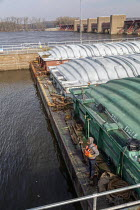 16-11-2019 - Illinois City, USA, tugboat pushing barges containing corn and soybeans through Lock & Dam No. 16 on the upper Mississippi River. © Jim West