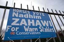 13-12-2019 - Horses Vote Nadhim Zahawi For Warm Stables, grafftti on a Conservatives general election poster referring to MPs expenses scandle when Millionaire Conservative MP Nadhim Zahawi claimed taxpayer's mone... © John Harris