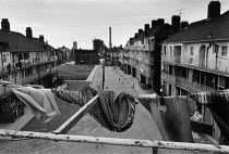 12-04-1984 - Washing on a line, blocks of flats, Vauxhall, Liverpool 1983 Tate and Lyle Sugar Refinery in the background © Dave Sinclair