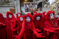 10-01-2020 - The Invisible Circus, Extinction Rebellion activists dressed in red robes and with white makeup Demand Action on Australian Fires, Australian High Commission, London © Jess Hurd
