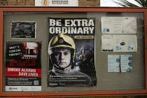 09-01-2020 - Be Extra Ordinary recruitment poster for retained firefighters, Stratford upon Avon Fire Station notice board, Warwickshire. Smoke Alarms Save Lives © John Harris