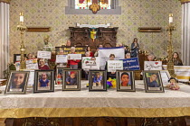 11-01-2020 - Detroit, Michigan USA, Holy Hour, supporting refugees fleeing violence, Most Holy Trinity Catholic Church. Photographs of children who died while in U.S. custody after crossing the border were placed... © Jim West