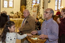 11-01-2020 - Detroit, Michigan USA, Holy Hour, supporting refugees fleeing violence, Most Holy Trinity Catholic Church. Parishoners commitments to prayer, fasting and action in support of migrants were collected i... © Jim West