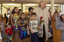 11-01-2020 - Detroit, Michigan USA, Holy Hour, supporting refugees fleeing violence, Most Holy Trinity Catholic Church.Mary Turner, right, escorting children bringing roses to the altar. The event was organized by... © Jim West