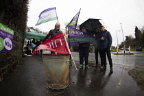 18-12-2019 - Northern Ireland Health Workers strike over safe staffing levels and pay parity, Downshire Hospital, Downpatrick. Attempting to Keep Warm in the rain © Conor Kinahan