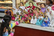 02-02-2020 - Oaxaca de Juarez, Mexico Fr. Hector Zavala Balboa celebrating mass, Sanchez Pascuas neighborhood market, Dia de la Candelaria, celebrating 40 days after the birth of Jesus. Families dress up dolls of... © Jim West